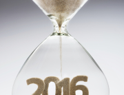 New Year 2016 concept with hourglass falling sand taking the shape of a 2016